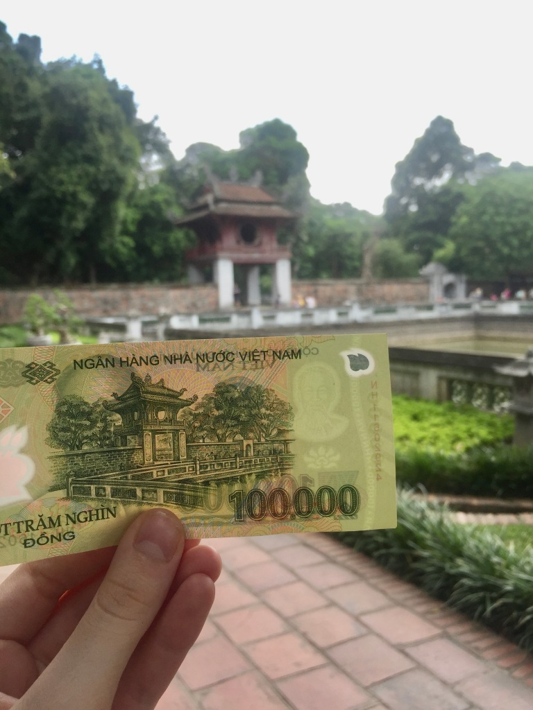 temple of literature and vietnam dong currency with same locations