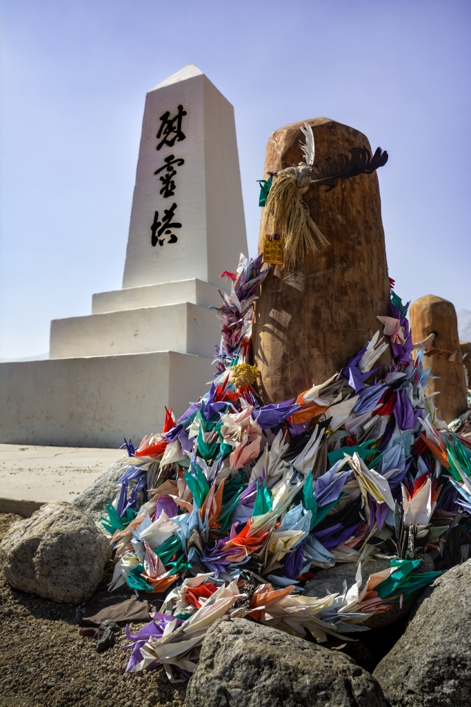 manzgnr monument white pillar and offerings paper cranes