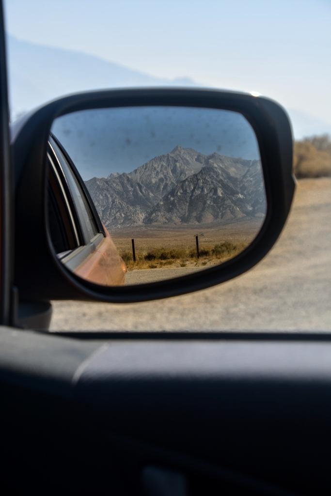 car rearview mirror of sierra nevada mountains
